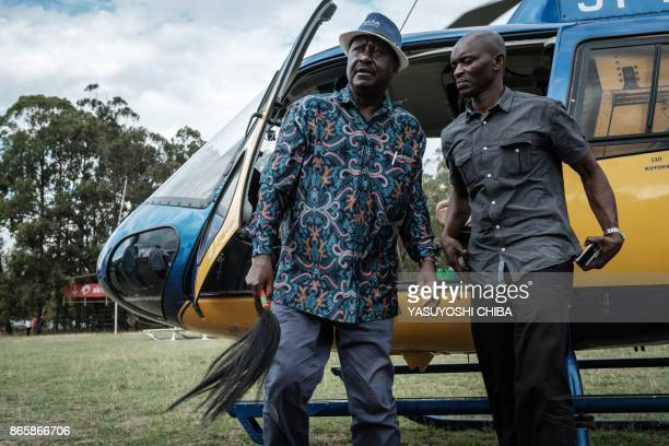 Kenya's opposition leader Raila Odinga of the opposition National Super Alliance coalition, arrives by helicopter to attend a political rally in...