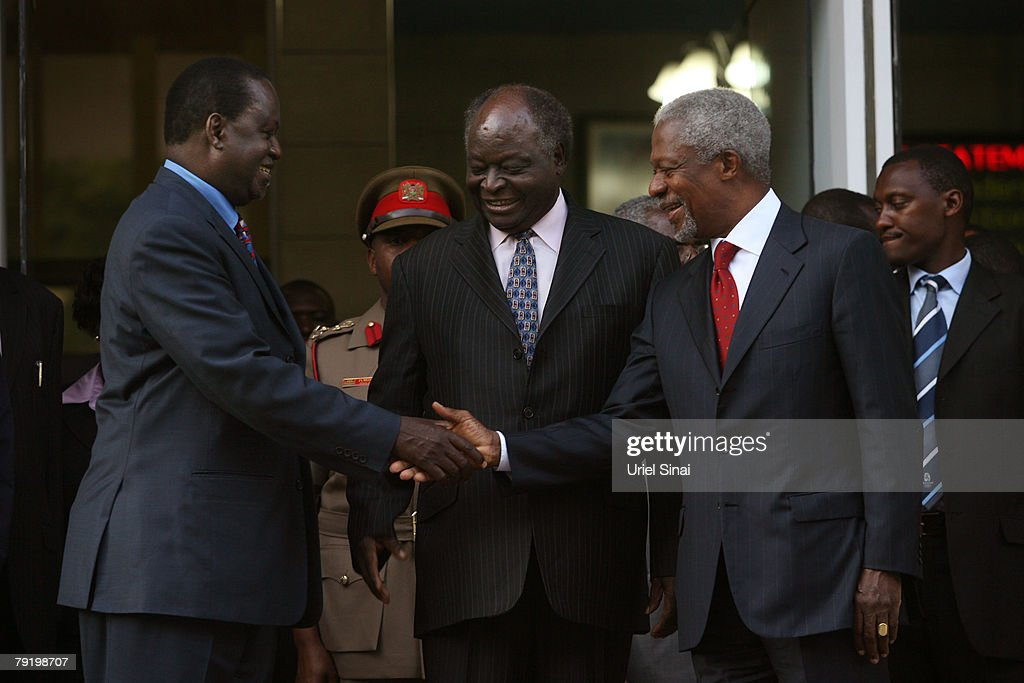 Kenya's opposition leader Raila Odinga (L) shakes hands with and former U.N. Secretary-General Kofi Annan as Kenyan President Mwai Kibaki looks on during a press conference outside the president's office on January 24, 2008 in Nairobi, Kenya. The meeting between the two rivals is the first since the disputed presidential election that led to bloodshed across the country.