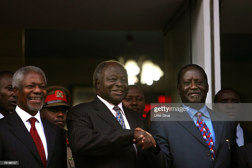 Kenya's opposition leader Raila Odinga (R) shakes hands with Kenyan President Mwai Kibaki (C) as former U.N. Secretary-General Kofi Annan stands beside, during a press conference outside the president's office on January 24, 2008 in Nairobi, Kenya. The meeting between the two rivals is the first since the disputed presidential election that led to bloodshed across the country.
