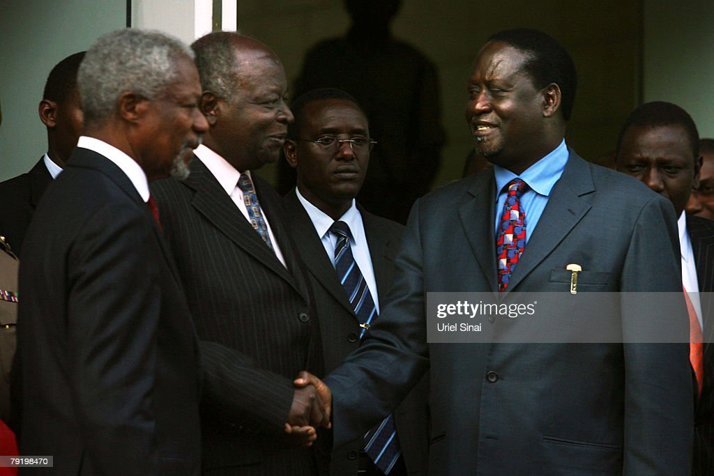 Kenya's opposition leader Raila Odinga (R) shakes hands with Kenyan President Mwai Kibaki (C) as former U.N. Secretary General Kofi Annan stands beside them during a press conference outside the presidential office on January 24, 2008 in Nairobi, Kenya. The meeting between the two rivals is the first since the disputed presidential election that led to bloodshed across the country.