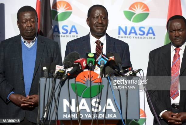 Kenya's opposition leader Raila Odinga speaks flanked by coprincipal Musalia Mudavadi and NASA's presidential running mate Kalonzo Musyoka during a...