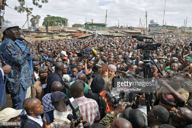 Kenya's opposition leader Raila Odinga speaks on August 13 2017 in the Kibera district of Nairobi Kenya's defeated opposition leader Raila Odinga on...
