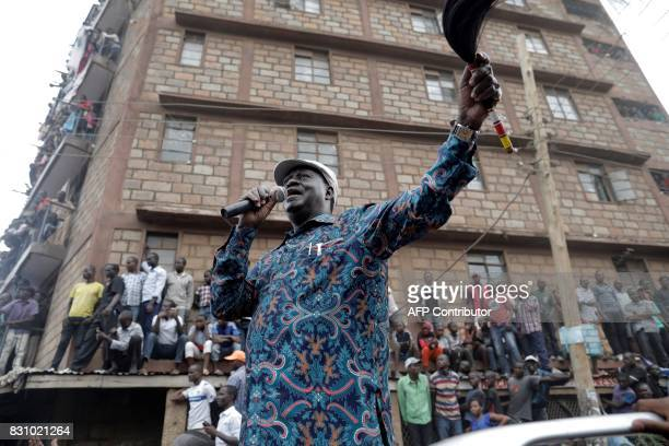 Kenya's opposition leader Raila Odinga speaks to supporters on August 13, 2017 in the Mathare district of Nairobi. Kenya's defeated opposition leader...