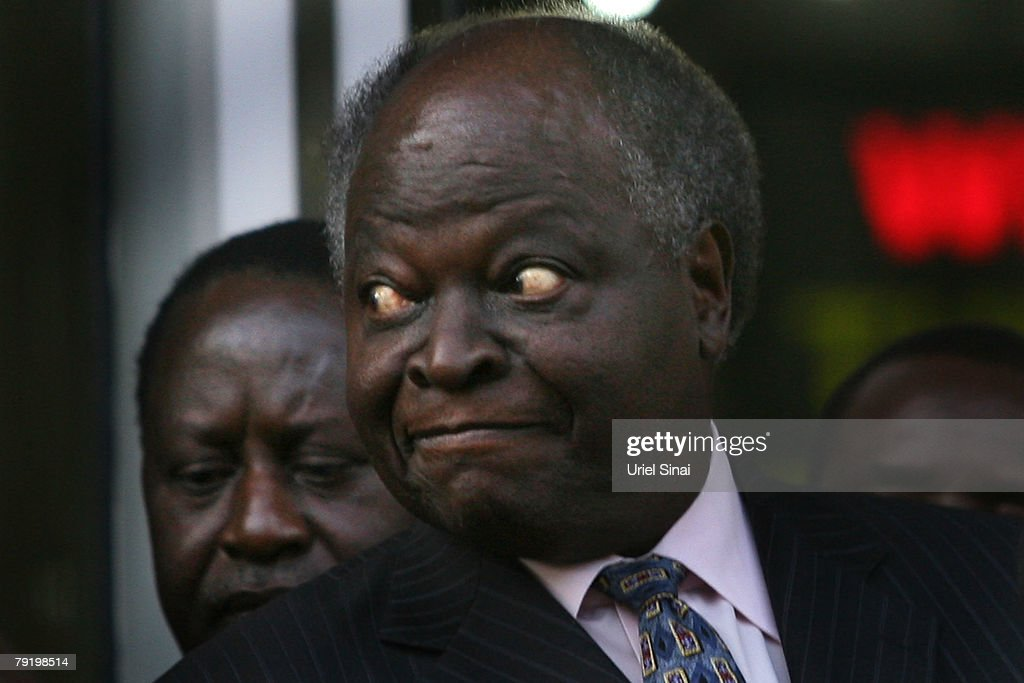 Kenya's opposition leader Raila Odinga stands behind Kenyan President Mwai Kibaki during a joint press conference outside the president's office on January 24, 2008 in Nairobi, Kenya. The meeting between the two rivals is the first since the disputed presidential election that led to bloodshed across the country.