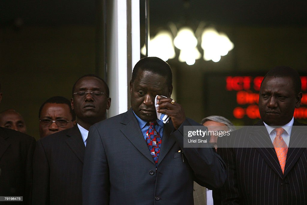 Kenya's opposition leader Raila Odinga wipes his eye during a joint press conference with Kenyan President Mwai Kibaki and former U.N. Secretary-General Kofi Annan outside the president's office on January 24, 2008 in Nairobi, Kenya. The meeting between the two rivals is the first since the disputed presidential election that led to bloodshed across the country.