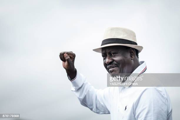 Kenya's opposition party National Super Alliance leader Raila Odinga raises his fist to supporters at Ruaraka in Nairobi on November 19 2017 Four...