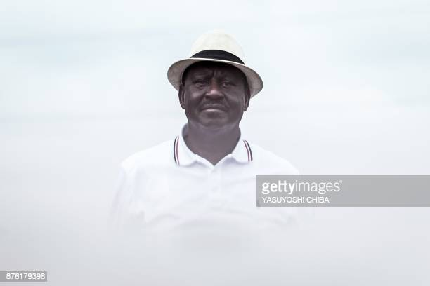 Kenya's opposition party National Super Alliance leader Raila Odinga looks at supporters after giving a speech at Ruaraka in Nairobi on November 19...