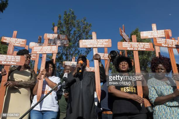 Kenya's opposition party National Super Alliance Raila Odinga and other National Resistance Movement leaders hold crosses of the victims alledgedly...