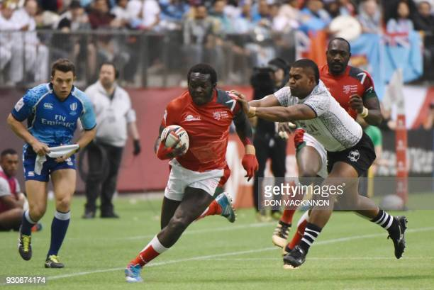 Kenya's Oscar Ouma is knocked down by Fiji's Vatemo Ravouvou at the HSBC Canada Men's Sevens in BC Place Stadium in Vancouver BCCanada March 11 2018...