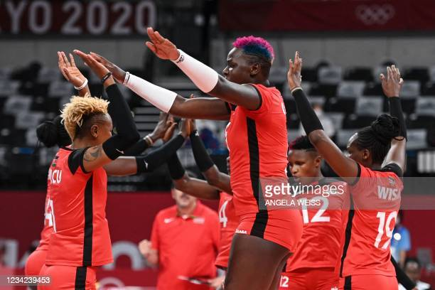 Kenya's players react in the women's preliminary round pool A volleyball match between South Korea and Kenya during the Tokyo 2020 Olympic Games at...
