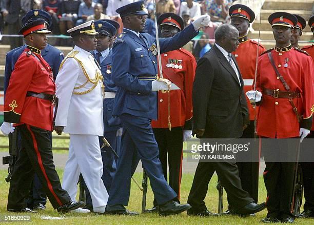 Kenya's President Mwai Kibaki accompanied by the Chief of General Staff Joseph Kibwana and Leutenant Colonel A Kin'oo inspects the honour guard 12...