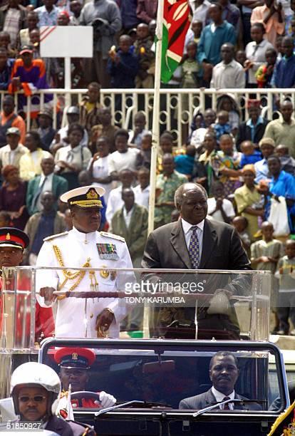 Kenya's President Mwai Kibaki arrives 12 December 2004 at Nyayo stadium in Nairobi for the 41st Jamhuri day celebrations accompanied by the Chief of...