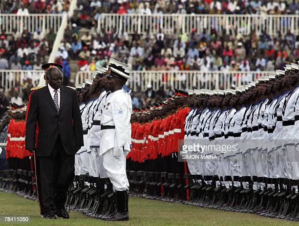 Kenya's president Mwai Kibaki inspects a guard of honour mounted by Kenya Military officersduring this year's 44th Jamhuri Day Celebrations 12...