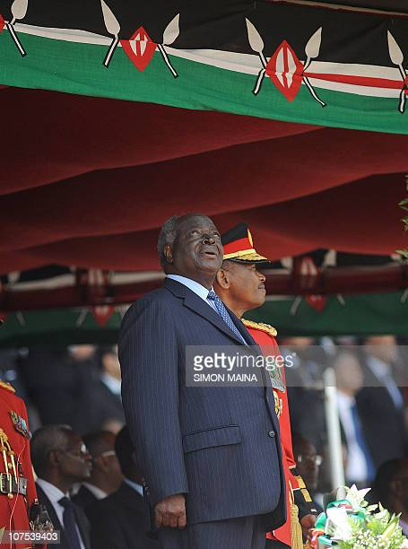 Kenya's president Mwai Kibaki looks at military jets as they parade during commemorations of Kenya's 47th Independence anniversary on December 12...