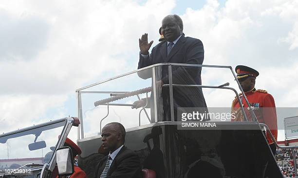 Kenya's President Mwai Kibakito waves from his car as he arrives to mark 47th Jamhuri day on December 12 2010 at the Nyayo national stadium in...