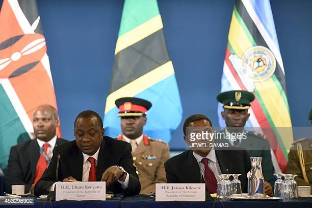 Kenya's President Uhuru Kenyatta and Tanzania's President Jakaya Kikwete attend in a roundtable discussion with American and African business leaders...