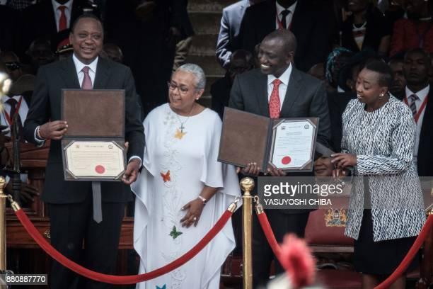 Kenya's President Uhuru Kenyatta and VicePresident William Ruto hold certificates during the inauguration ceremony at Kasarani Stadium in Nairobi on...
