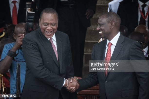 Kenya's President Uhuru Kenyatta and VicePresident William Ruto shake hands after taking oath of office during the inauguration ceremony at Kasarani...