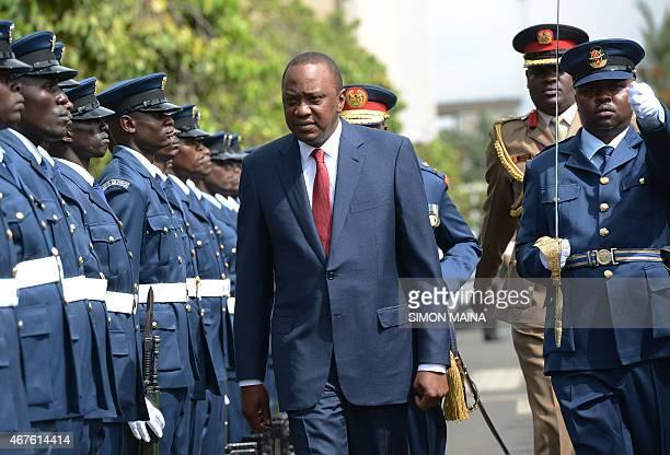 Kenya's President Uhuru Kenyatta arrives before addressing the parliament on March 26 2015 in Nairobi President Kenyatta's speech comes against the...