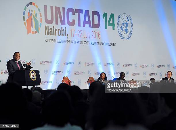 Kenya's President Uhuru Kenyatta delivers a speech during the opening session of the United Nations Conference on Trade and Development on July 17...