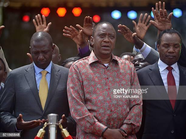 Kenya's President Uhuru Kenyatta Deputy president William Ruto and former minister Henry Kosgeylook on as prayers are offered during an...