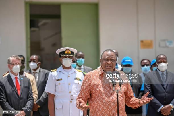Kenya's President Uhuru Kenyatta gives an address following his tour of the Nairobi National Vaccine Depot where the country's first batch of...