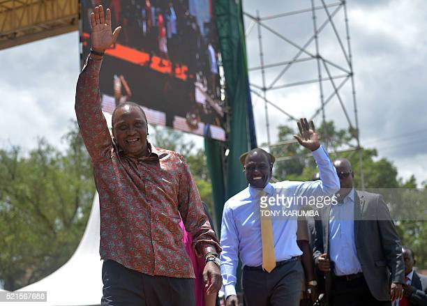 Kenya's President Uhuru Kenyatta his wife Margaret and Deputy president William Ruto arrive at Nakuru's Afraha stadium on April 16 to attend a thanks...