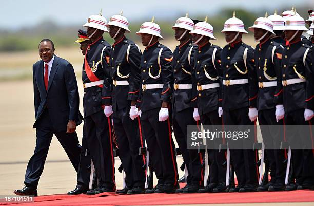 Kenya's President Uhuru Kenyatta inspects a guard of honour mounted by the Botswana Defence Force soldiers as he arrives on November 6 2013 for an...