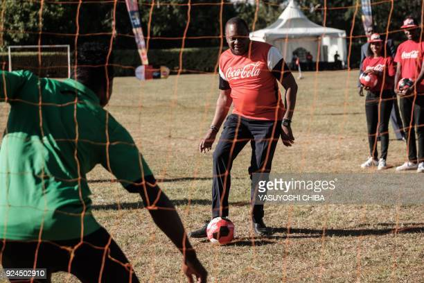 Kenya's President Uhuru Kenyatta kicks the ball during a football exhibition match as part of the FIFA World Cup Trophy Tour at the State House in...