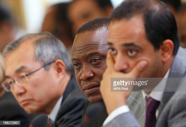 Kenya's President Uhuru Kenyatta listens as Prime Minister David Cameron opens during the Somali conference on May 7 2013 in London England The...