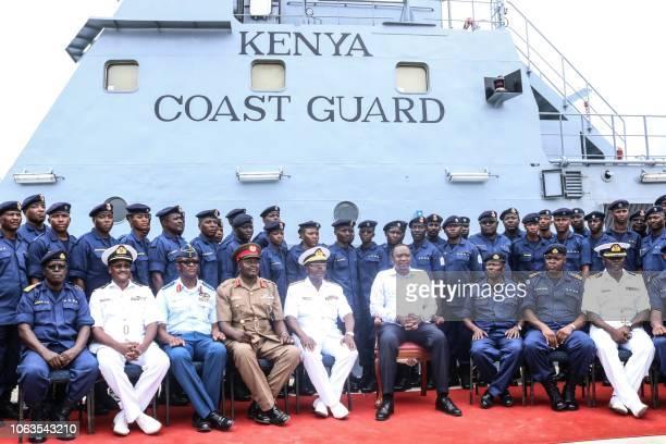 Kenya's President Uhuru Kenyatta poses on November 19 2018 aboard the MV Doria a 54meterlong offshore patrol vessel of the Kenya Coast Guard Service...