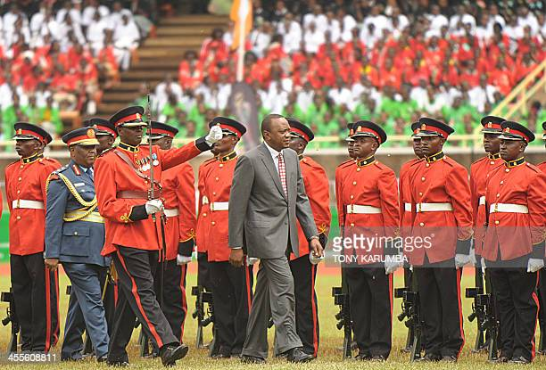 Kenya's President Uhuru Kenyatta reviews the guard of honour during the celebrations marking Kenya's independence 50th anniversary on December 12...