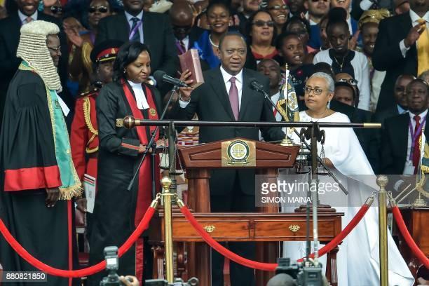 Kenya's President Uhuru Kenyatta takes oath of office during his inauguration ceremony at Kasarani Stadium on November 28 2017 in Nairobi Kenyatta...