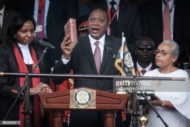 Kenya's President Uhuru Kenyatta takes oath of office during his inauguration ceremony at Kasarani Stadium in Nairobi Kenya on November 28 2017...