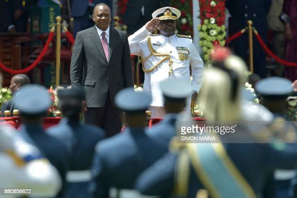 Kenya's President Uhuru Kenyatta views the past out parade before taking oath of office during his inauguration ceremony at Kasarani Stadium on...