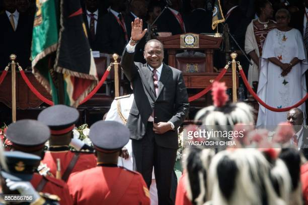 TOPSHOT Kenya's President Uhuru Kenyatta waves to guards of honour upon his arrival to take oath of office during his inauguration ceremony at...