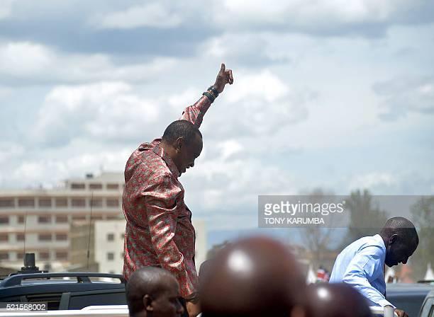 Kenya's President Uhuru Kenyattaand Deputy president William Ruto arrive for an interreligious ceremony thanks giving ceremony at the Afraha stadium...