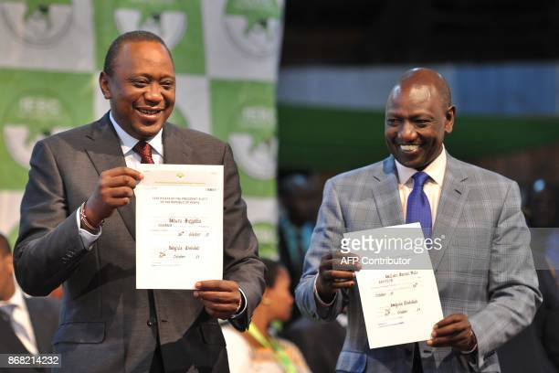 Kenya's presidentelect Uhuru Kenyatta with his running mate William Ruto hold up certificates of election October 30 2017 at the national tallying...