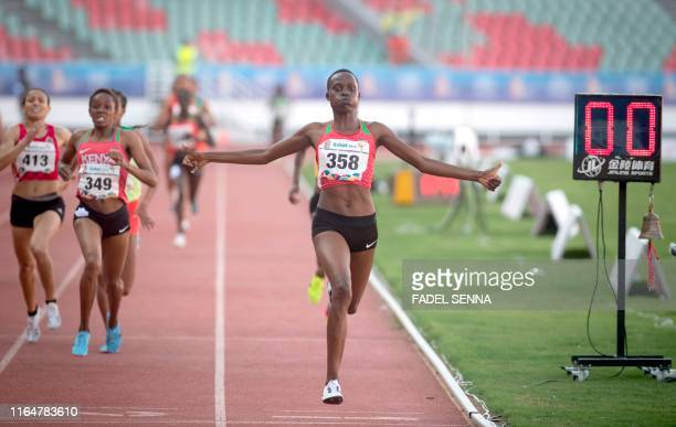 Kenya's Quailyne Jebiwott Kiprop crosses the finish line and wins the Women's 1500m Final at the 12th edition of the African Games in Rabat on August...