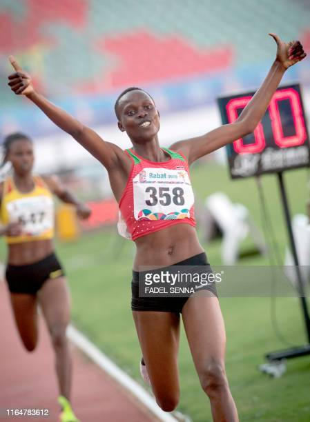 Kenya's Quailyne Jebiwott Kiprop reacts after crossing the finish line during Women's 1500m Final at the 12th edition of the African Games in Rabat...