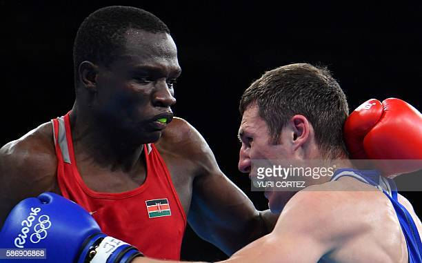 Kenya's Rayton Nduku Okwiri fights Russia's Andrei Zamkovoi during the Men's Welter boxing match at the Rio 2016 Olympic Games at the Riocentro...
