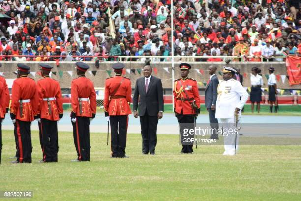 Kenya's reelected President Uhuru Kenyatta seen inspecting the guards of honor to mark his inauguration The President Uhuru Kenyattawas reelected on...