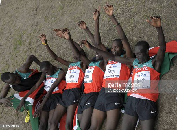 Kenya's Richard Kipkemboi Mateelong Hosea Mwok Macharinyang Paul Kipngetich Tanui Leonard Patric Komon Lucas Kimeli Rotich and Joseph Ebuya lay on...