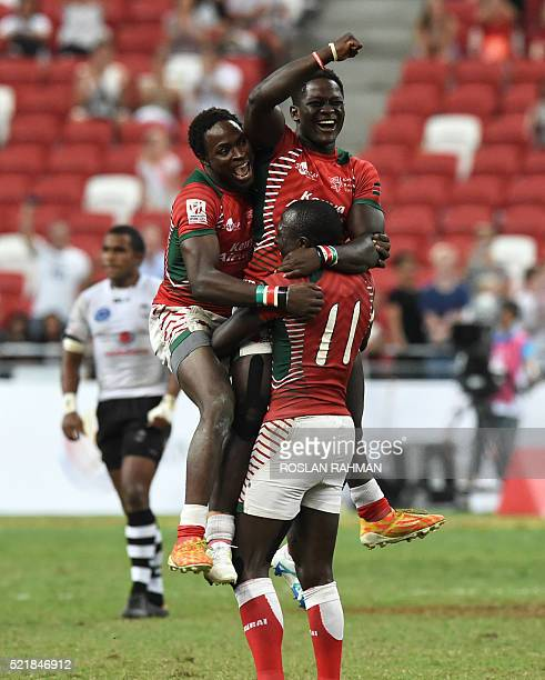 Kenya's Robert Aringo celebrates with teammates after defeating Fiji in the cup final at the Singapore Sevens rugby tournament on April 17 2016 / AFP...