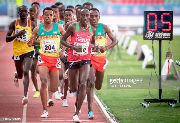 Kenya's Robert Kiprop crosses the finish line during Men's 5000m Final at the 12th edition of the African Games in Rabat on August 30 2019