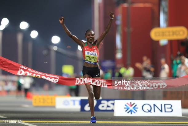 Kenya's Ruth Chepngetich celebrates after winning the Women's Marathon at the 2019 IAAF World Athletics Championships in Doha on September 27 2019