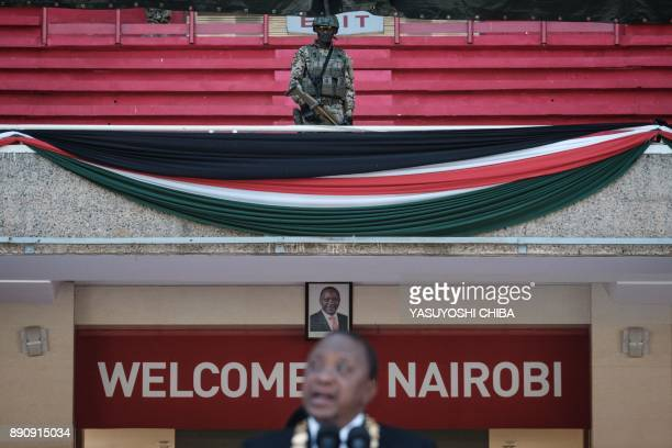 Kenya's special force soldier stands guard as Kenya's President Uhuru Kenyatta delivers a speech during the Independence Day ceremony called Jamhuri...
