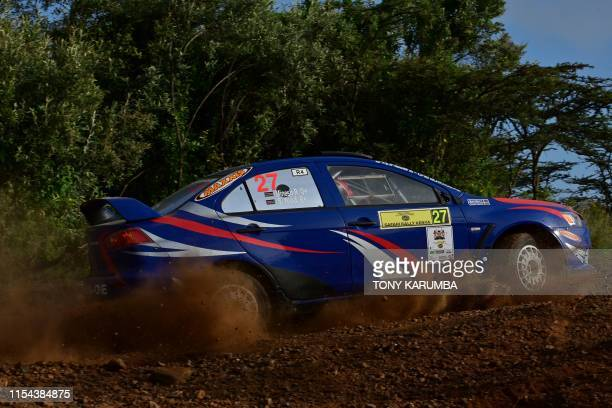 Kenya's team Minesh Rathod and Shameer Yusuf navigate a sharp turn in their Mitsubishi Lancer Evo10 on the second race of the third and last day of...