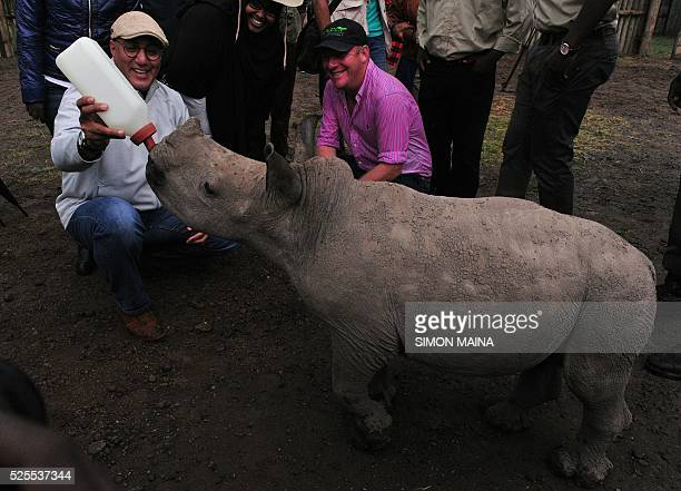 Kenya's Tourism Cabinet Secretary Najib Balala poses next to a southern white rhinoceros at Ol Pejeta Sanctuary during the Giants Club Summit...
