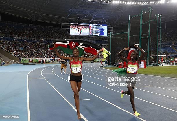 Kenya's Vivian Jepkemoi Cheruiyot and Kenya's Hellen Onsando Obiri celebrate after finishing respectively first and second of the Women's 5000m Final...